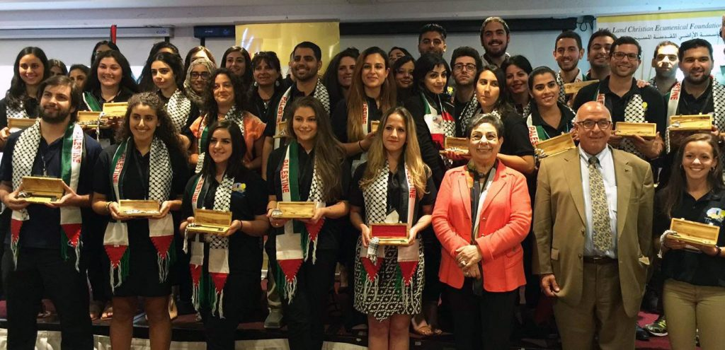 KTH Delegates and Homecoming Journey participants stand with Sir Rateb Rabie and Dr. Ashrawi